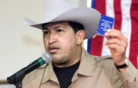 Chavez held a copy of his nation's constitution during a visit to a refinery in Corpus Christi, Texas, in 2001.
