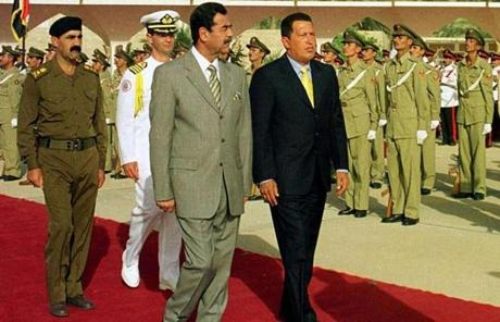 Chavez, right, walked with Saddam Hussein during a visit to Iraq in 2000.