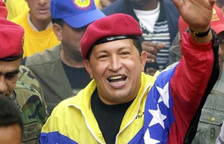 Chavez waved to supporters during a 2002 march in Caracas commemorating the anniversary of Venezuelan democracy.