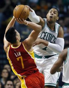 Boston Celtics' Jared Sullinger (7) blocks a shot by Houston Rockets' Jeremy Lin (7) in the third quarter of an NBA basketball game in Boston, Friday, Jan. 11, 2013. The Celtics won 103-91. (AP Photo/Michael Dwyer)