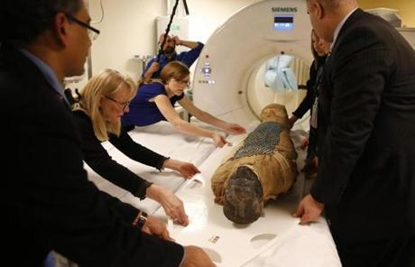 Dr. Rajiv Gupta, Mimi Leveque, Rebecca Barber, and Joe Faye loaded the mummy known as Padihershef into a CT scanner at Massachusetts General Hospital.
