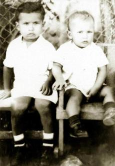 Hugo Chavez (right), with brother Adam, grew up in poverty, reared by his grandmother.