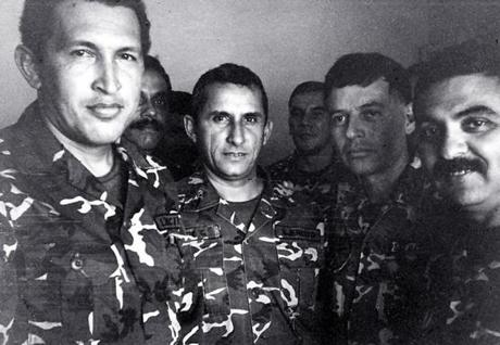 Mr. Chavez (left), in jail after his arrest in a coup attempt.