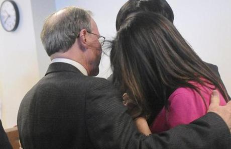 Lauren Astley's father, Malcolm Astley, hugged Fujita's parents after the verdict.