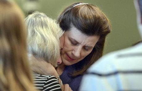 Prosecutor Lisa McGovern (right) hugged Mary Dunne, mother of Lauren Astley.