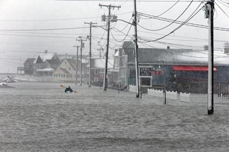 This kayaker in the Brant Rock area of Marshfield had the best means of transportation, as flooding left the streets inacessible to anyone but boaters.