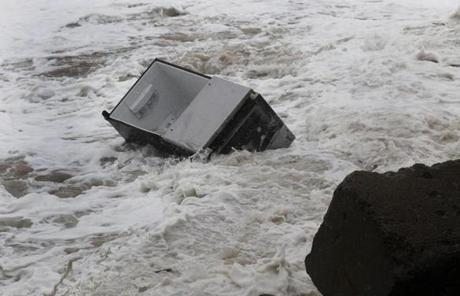 A fridge floated down the beach at Plum Island.