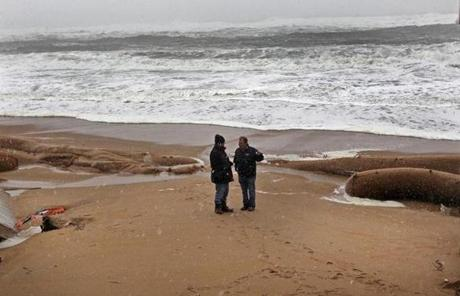 Homeowner Bob Connor (right) walked with emergency worker Dave Lager on the Plum Island beach.