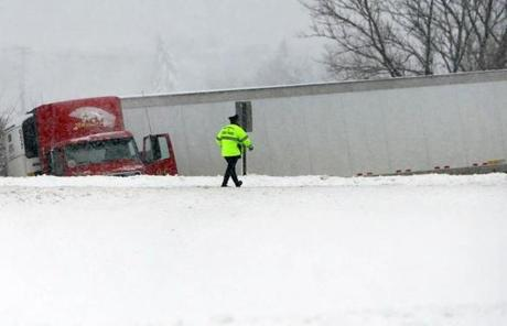 A  tractor-trailer jackknifed on Route 495 west in Raynham.