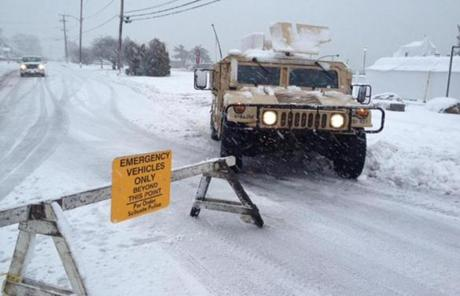 A humvee was parked near a closed road in Scituate.