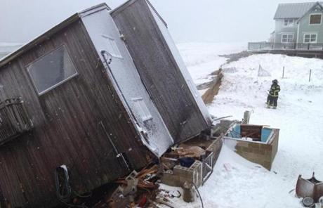 Pounding surf whipped up by a strong ocean storm ripped a home from its foundations on Plum Island on March 8.