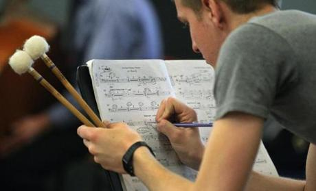 "Boston Opera Collaborative timpanist David Luidens makes a notation during a rehearsal of ""Dead Man Walking."""