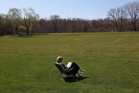 At Cold Spring Park in Newton, people enjoyed the unseasonably warm weather. Emily Anthony took her lunch break on a lawn chair with a book.