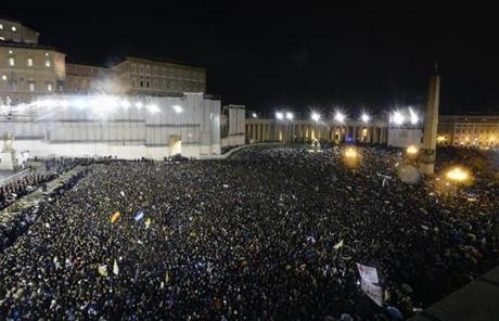 The massive crowd waved flags and signs as they packed St. Peter's Square.