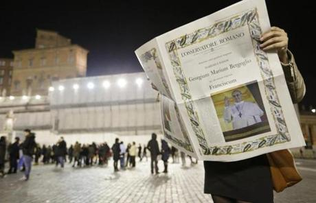 A reader held the first edition of the Vatican newspaper L'Osservatore Romano after the election of Pope Francis.
