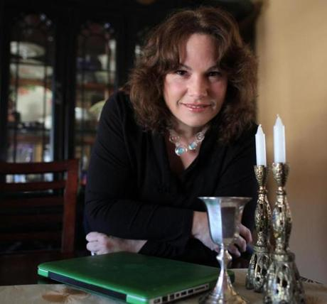 Linda Freeman Goodspeed will be using a laptop to include family members from western United States during Passover Seder at her home in Beverly.