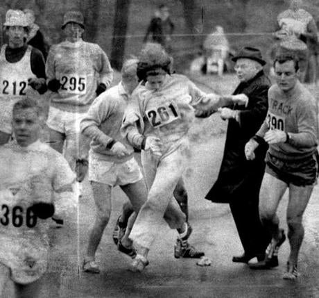 Sports/ BG scan Hopkington Ma. 4/19/1967 a hassle at the start of the BAA Marathon, as marathon director attempts to stop women runner 261 from competing. Other runners objected to Cloney's provincial attitude. number 261 was listed on the program as K. Switzer of Syracuse. Switzer remained in the marathon. United Press. International photo. Boston Marathon preivew, year of the women. bostonmarathon1967 -- Marathonhistory