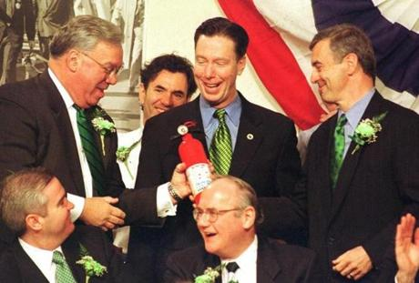 Governor Paul Cellucci, right, handed a gag fire extinuisher