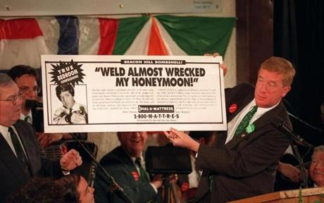Mayor Thomas Menino listened as Governor Bill Weld held up a sign poking fun at Senator John Kerry in 1996.