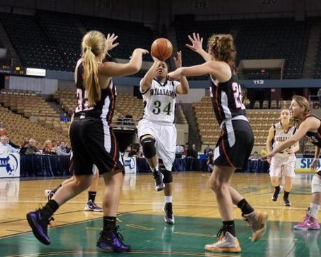Archbishop Williams guard Ednaija Lassiter (34) drives through Lee defenders Courtney Picard (32) and Stephanie Young (22) to the hoop during the Div. 3 Girl's State Basketball Finals at the DCU Center in Worcester.