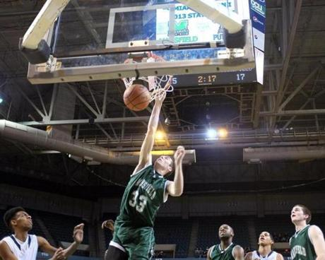 Mansfield forward Gregory Romanko (33) dunks against Palmer Voc/Tech High during the Div. 1 Boy's State Basketball Finals at the DCU Center in Worcester.