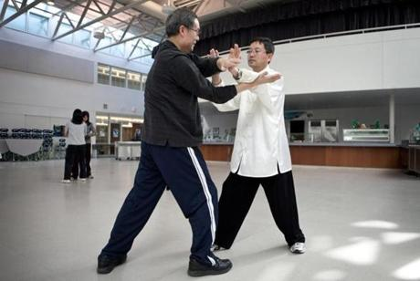 Wenxin Ma(left) and Kevin Wang participate in an adult Tai Chi class, which is part of the Culture Programs of the Acton Chinese Language School.