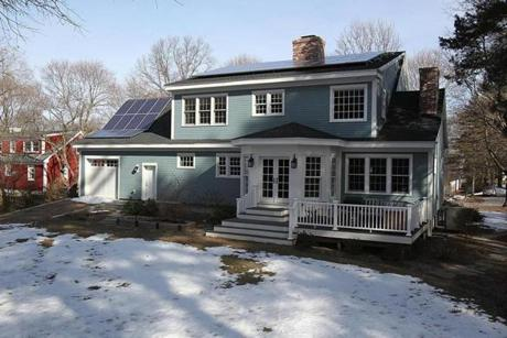 Solar panels are visible on the roof of Brian Foulds' Concord home, which will be part of an eco-friendly house tour.