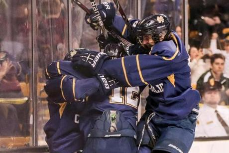 Somewhere in the tangle of joyous Malden Catholic skaters is Austin Goldstein, whose goal with two minutes remaining in the first period put the Lancers up for good.