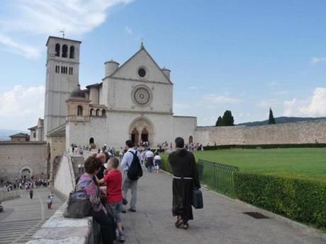 A friar is among those heading into the basilica, which has paintings and frescoes from that time by Giotto, Cimabue, and Torriti.