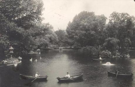 May 11, 1911: Looking north across the pond from the suspension bridge on a typical weekend, one saw rowboats and swans. Renting and rowing small boats across the Public Garden's lagoon was a favorite activity of many Bostonians as was riding in the Swan Boats which began operation in 1877.