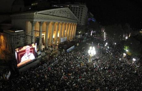 Argentines watched the inaugural Mass on a giant screen next to the Metropolitan Cathedral in Buenos Aires.
