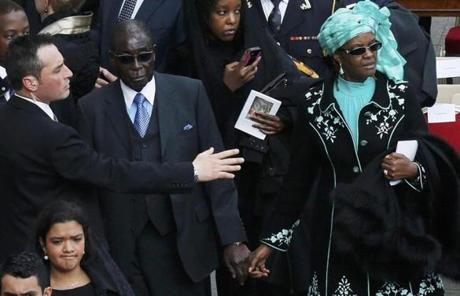 Zimbabwe's President Robert Mugabe and his wife Grace attended the Mass.
