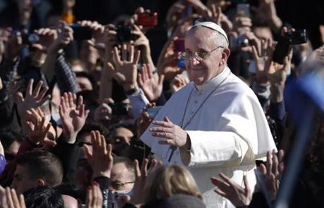 Pope Francis waved to the fervent crowd as he arrived to his installation Mass in St. Peter's Square.