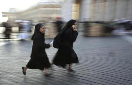 Nuns ran through St. Peter's Square to get a good vantage point.
