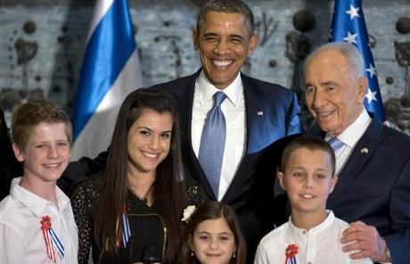 President Obama and Israeli President Shimon Peres with children who sang to them at Peres's residence in Jerusalem.