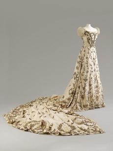 A House of Worth gown of silk with silver and gold thread and bullion work.