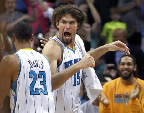 Hornets forward Anthony Davis (left) celebrated with center Robin Lopez after Davis scored the game-winning basket against the Celtics.