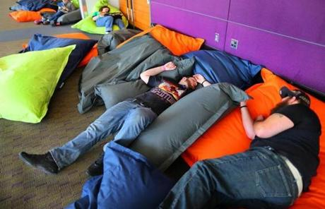 Some gamers took a nap in a convention center lounge.