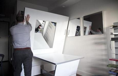 Hidden storage is also common in micro-units, such as this dining table that folds down for a Murphy bed.