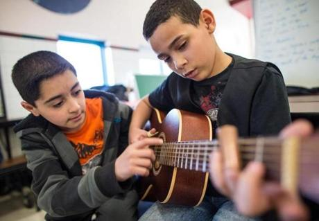 Students Karrar Daffaie (left) and Jorge Ocasioduring practiced playing.