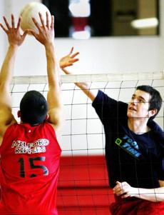 Milford Boys Volleyball Practice Co-Captain Kane Wittorff (right) goes through drills at practice.