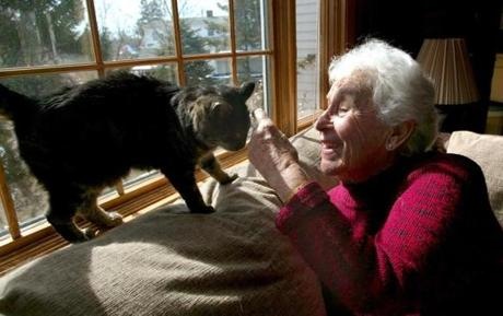 Alba Thompson, who was Plymouth's first female selectman, played with her cat at her home.