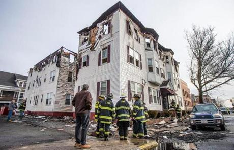 A four-alarm fire that broke out at a three-story apartment building around midnight Sunday.