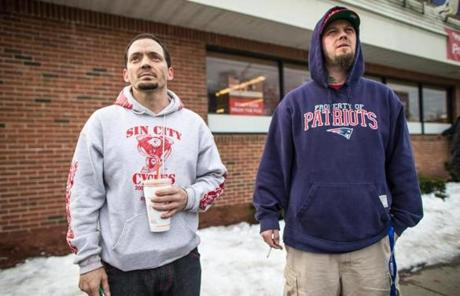 Shawn Claffey (left), a resident of the building, and his brother, Stephen Claffey, looked at the building's burnt remains.