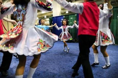 Dancers from the Peter Smith School of Irish Dance in New Jersey practiced their mixed under-13 ceili dance for The World Irish Dancing Championships being held at the Hynes Convention Center. It is only the second time in its 40-year history that the eight-day event was held outside Ireland and Scotland. Organizers expected 20,000 people from around the globe to attend.