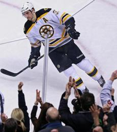 The Garden fans salute Patrice Bergeron after he beat Toronto's James Reimer in the shootout.