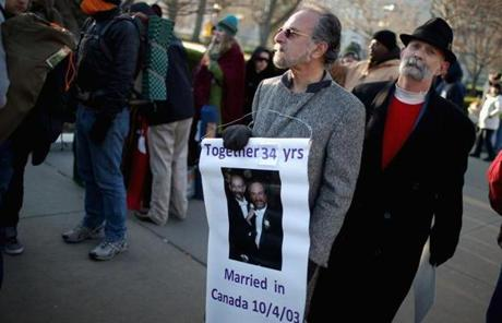 Michael Sabatino (left) and Robert Voorheis of Yonkers, N.Y., joined hundreds of others outside the Supreme Court.