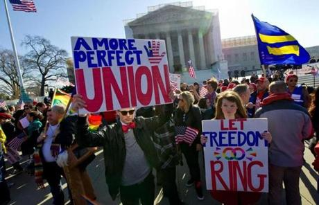 Gay marriage supporters marched at the US Supreme Court on Wednesday.