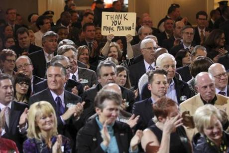 A sign in the crowd at Faneuil Hall as Mayor Thomas M. Menino announced that he will not seek reelection.