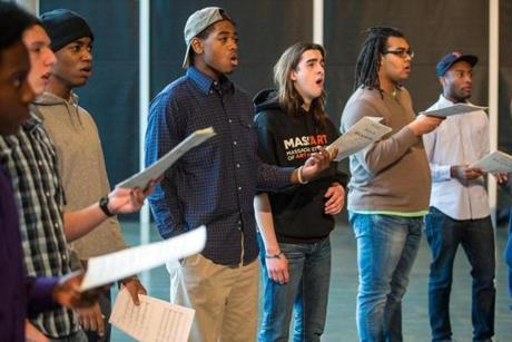 "Chorus members prepare for concerts that will feature the world premiere of a multimedia piece titled ""A Boy Called King."""
